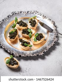 Sandwiches with salmon black caviar  on concrete background