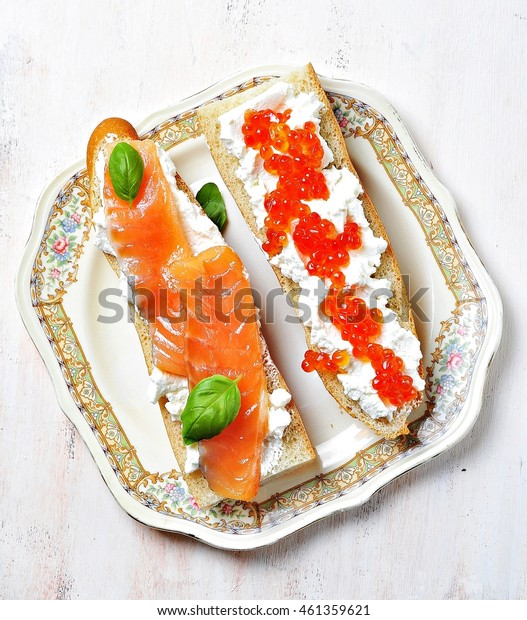 sandwiches with soft cheese and smoked salmon caviar