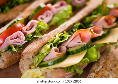 Sandwiches with swiss cheese, ham and vegetables