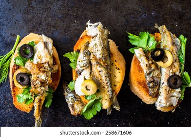 Sandwiches, tapas with grilled fish, capelin, sprats, sardines