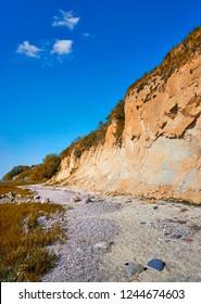 Sandy Baltic Sea cliff at the Baltic Sea beach.