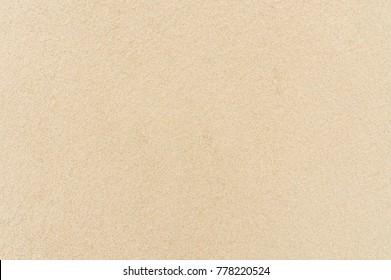 Sandy beach background. Sand texture