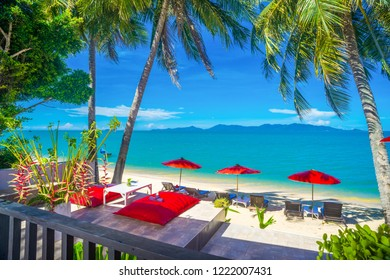 Sandy beach is beautiful and peaceful.Sunbed with umbrella in  tropical calm beach and palm or coconut trees at Maenam beach Koh Samui Surat Thani Thailand