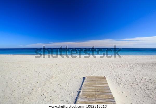Sandy beach and blue sea, beautiful summer landscape