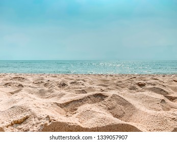 Sandy beach with a blue sky