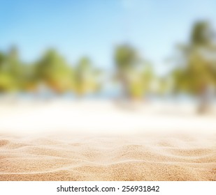 Sandy beach with blur sea on background