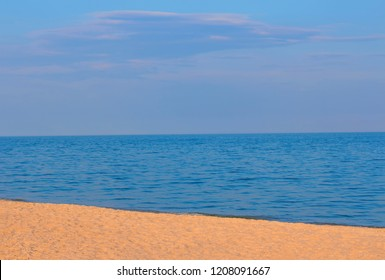 sandy beach and calm sea water