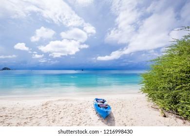 Sandy beach with canoe park.