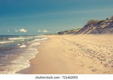 Sandy beach and cliffs on Baltic sea coast, Poland, Rowy