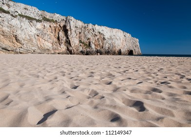 Sandy beach with cliffs in Portugal