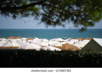 Sandy beach covered by umbrellas in Jesolo, Italy