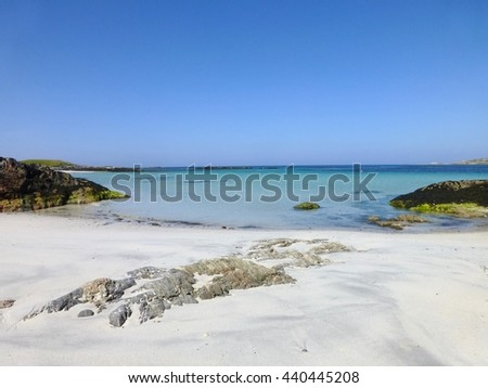 Sandy beach and crystal clear blue green water on a sunny summer's day at Caolas, Isle of Tiree, Scotland