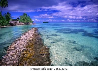 Sandy beach and crystal clear lagoon on the island of Moorea French Polynesia