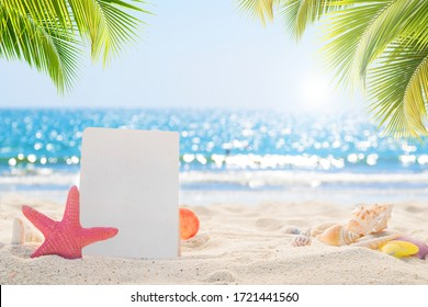 Sandy beach with empty paper card for message design. blur sea on background. Tranquil beach scene for travel inspirational. Summer exotic holiday and vacation concept for tourism relaxing.