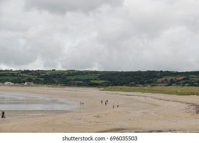 Sandy beach at low tide in Cornwall, England