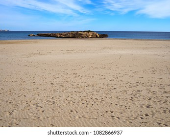 Sandy beach with many human foot prints great for summer vacation