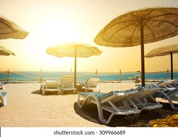 Sandy beach near red sea at sunset