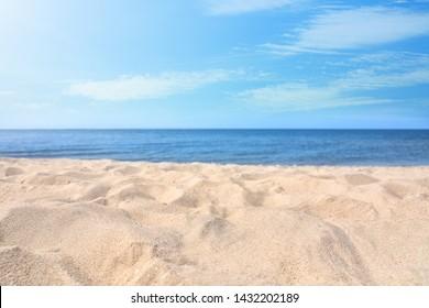 Sandy beach near sea on sunny day