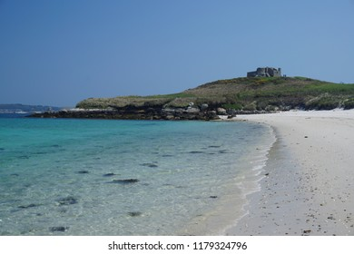 A sandy beach and the Old Blockhouse on Tresco island, Isles of Scilly, UK