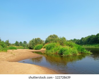 Sandy beach on the river Mologa. Russia. Novgorod region.