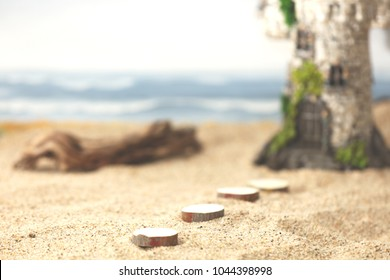 A sandy beach with pavers leading to a fairytale magic castle with ocean waves crashing in the background.