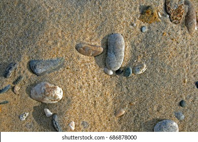 Sandy beach with pebbles as background