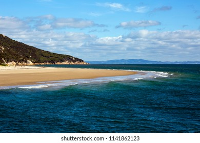 A sandy beach protrudes out like a finger from Wilsons Promontory National Park into Corner Inlet in South Gippsland, Victoria, Australia.
