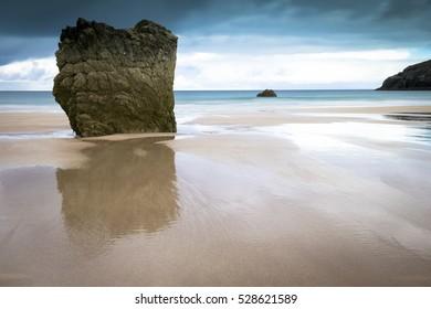 Sandy Beach Rocks and Blues Sea