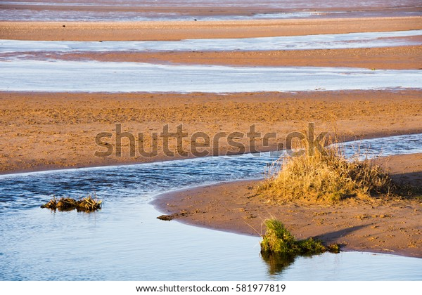 Sandy beach at Sandscale Haws during the evening sunset