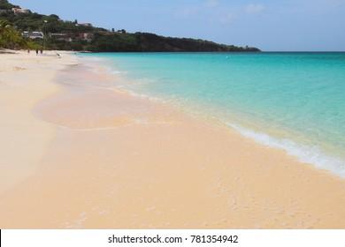 Sandy beach, sea and cape. St. George's, Grenada