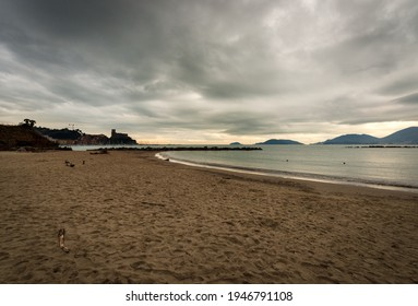Sandy beach and seascape in winter. Lerici town, tourist resort in Gulf of La Spezia also called Gulf of Poets, Liguria, Italy, Europe. On the horizon the Palmaria and Tino islands. Porto Venere.