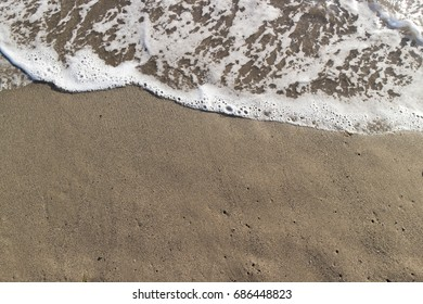 Sandy beach with small waves - tuscany impressions