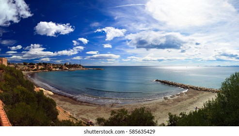 Sandy beach in Spain, the Mediterranean coast of the Costa Blanca, the beautiful clouds and sea bay