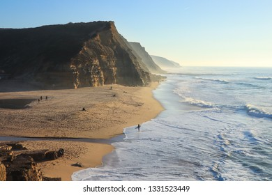 Sandy beach at the sunset. Portugal