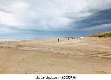 Sandy beach with thunder clouds