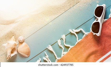 Sandy beach with Beach towel and sunglasses