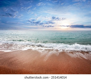 Sandy beach and the waves of the Mediterranean Sea