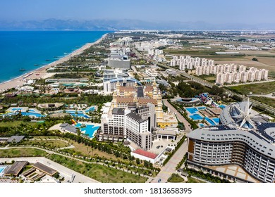 Sandy beaches of the Mediterranean. Kundu holiday complex with five star hotels. Beach, sea, water sports, parasailing, entertainment and shopping center. Aerial view with drone. Kundu, Lara -TURKEY