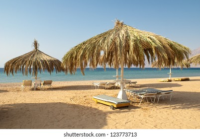 Sandy beaches with umbrella and sunbeds