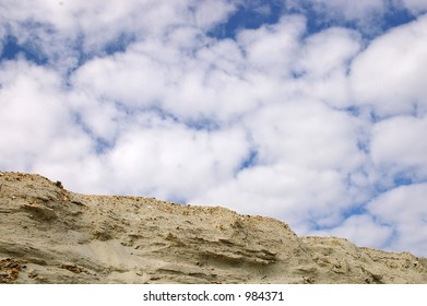 Sandy cliff and sky