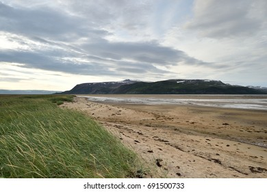 Sandy coast with mountain in Tanamunningen Nature Reserve in Norther Norway