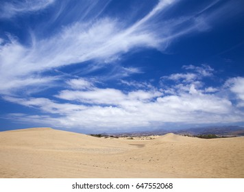 sandy Dunas de Maspalomas, Gran Canaria, view towards the center of the island,  cirrus clouds above