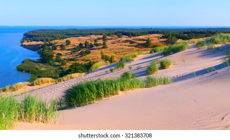 Sandy dunes during sunset. Curonian Spit, Lithuania.
