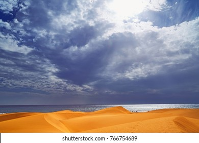 Sandy dunes of maspalomas in spain with blue, sky. Storm skay. Gran canaria.