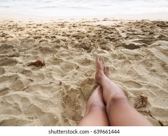 Sandy feet on the sand beach for relax time vacation day with copy space