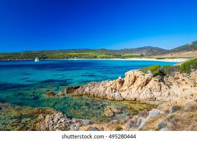 Sandy Grand Capo beach with red rocks near Ajaccio, Corsica, Europe.