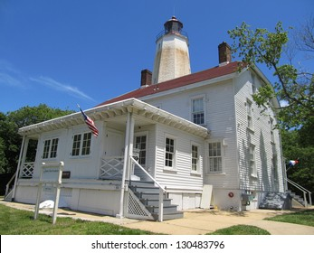 Sandy Hook Light Keeper's Residence (1883) and Lighthouse (1764). The lighthouse is the oldest working in the US today. The lighthouse is located within Gateway National Recreation Area in New Jersey
