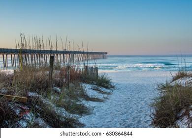 Sandy Panama City Beach Pier at Sunrise in Panama City, Florida