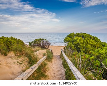 Sandy pathway leading to Torquay Beach, Australia. The Great Ocean Road starts at Torquay and travels 244 kilometres along the Victorian coastline.