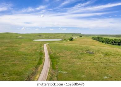 sandy ranch road in Nebraska Sandhills, summer aerial view